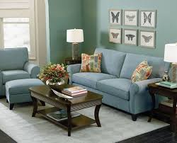 light blue living room furniture. the bluegreen wall and light blue couch create a relaxing space with cool green living roomsliving spacesgreen room furnitureblue furniture o