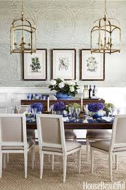 In the dining room, Schumacher's Feather Bloom sisal wallpaper by Celerie  Kemble