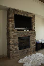 corner gas fireplace with tv above designcreative me