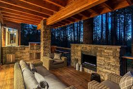 stone and wood outdoor deck with barbecue zone and fireplace design jenifer giudice