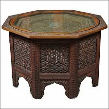 charming dark brown round vintage oriental asian carved wood coffee table with glass top design