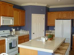 pleasurable blue colors for kitchen walls with wooden clear varnished cabinets with white ceramic countertops in