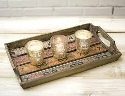 wooden centerpiece tray pair our wood ruler serving trays with mercury glass candle shelters for a simply rustic centerpiece long wooden tray centerpiece uk