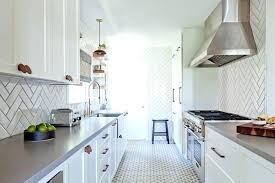 white tiles grey grout kitchen floor galley style with herringbone kitch