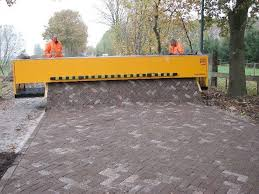 The Tiger Stone laying a brick road
