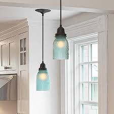 Kitchen pendant lights made from frosted-blue-glass mason jars. What's not  to