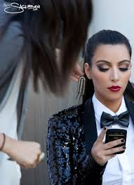 so if you follow kim kardashian s then you would have seen the behind the scenes of their photoshoot for their card if you didn t