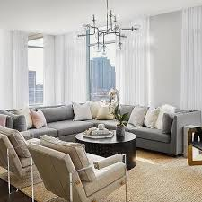 gray sectional with taupe leather accent chairs