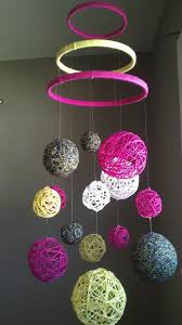 pink and yellow yarn fabric ball baby mobile 60 00 via this