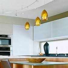 layers of light ceiling soffit holding track lighting and pendants serves as a design focal ambient track lighting