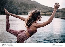 attractive female doing yoga pose