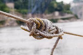 nœud emmêlé dans une corde serrée 1489860 Banque de photos