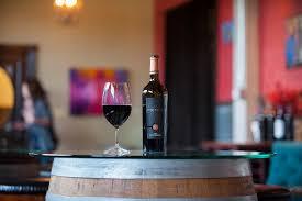 a bottle of basel cellars 2010 estate merriment on display at cellar 55 tasting room in