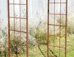 wrought iron trellis for climbing flowers also arch large size garden arbor with gate