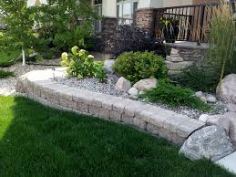 stone work around shrub bed on lake forest road