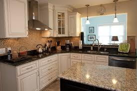 white shaker kitchen cabinets with granite countertops. Nice White Shaker Kitchen Cabinets And Incorporates Black Gloss Granite Image Of In Model 2016 With 1405412081435c Countertop Countertops