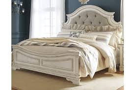 Realyn Queen Upholstered Panel Bed | Ashley Furniture HomeStore