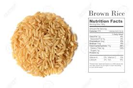 healthy brown rice uncooked with nutrition facts on white background stock photo 53771410