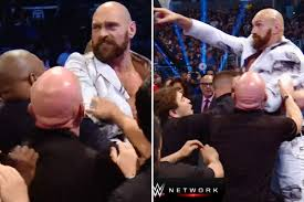 WWE Smackdown: Tyson Fury held back by security as he is ...