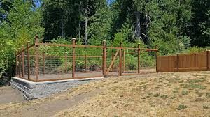 this steamboat island garden fence will keep the deer out of this raised garden area