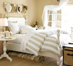stripped beige and white bed comforter with white bed skirt
