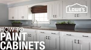 White painted kitchen cabinets Builder Grade How To Paint Cabinets Youtube How To Paint Cabinets Youtube