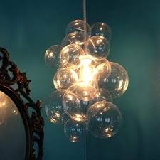 custom glass bubble chandelier art by day light at night uk