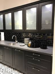 white frosted glass cabinets door black subway tile gray solid surface countertop pattern kitchen flooring stainless steel undermount sink