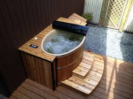 Very Small Bathtubs a tubfor2 oval cedar hot tub is perfect for small spaces 7058 by uwakikaiketsu.us