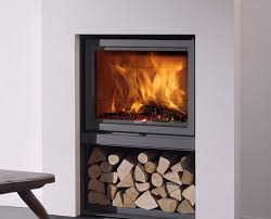 stûv 16 fireplace at home in any home this wood burning stove is easy to fit and is supplied with a decorative fire surround and integrated log storage