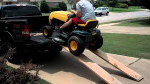 How not to get a lawn mower in your truck. - YouTube