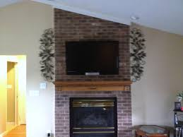 tv mounting over a fireplace with wires concealed in the for inspiring tv on brick fireplace