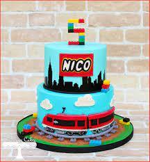 Lego City themed cake with train, tracks and skyline silhouette.  www.facebook.com/i.love.cuteology.cakes   Lego city cakes, Train cake, Cake