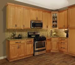 kitchen kitchen cabinet hardware chrome stainless sink near window double door brown wooden cabinets