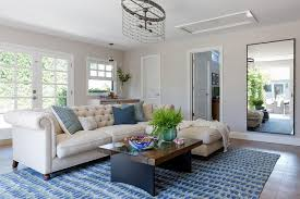 tan chesterfield sofa with blue rug living room blue rugs o44 rugs