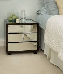 Furniture. dark brown wooden Bedside Table with glass drawer and short  legs. Unique Bedside