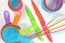 colorful kitchen utensils on white rustic background Stock Photo