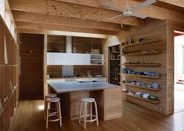 this australian kitchen is wrapped in tallowwood muuto pendant lights bar stools by alvar aalto for artek a vola faucet and a ceiling fan by beacon