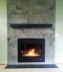 1 wood burning fireplace converted to a gas with new tile surround and custom made metal