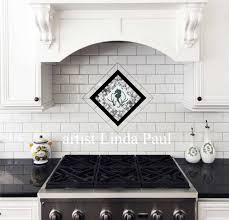 black and white kitchen with seahorse one piece backsplash