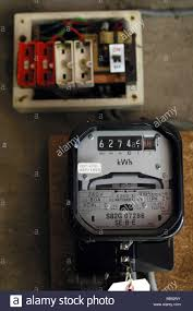 electric bills stock photos electric bills stock images alamy electric meter and a old style wire fuse box stock image
