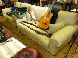 Pair Laura Ashley Kingston range Edwin Gold settee's, four scatter cushions  and four armcaps   Thomas Watson Auctioneers