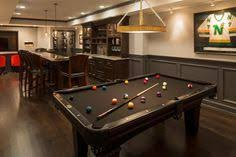 basement pool table. Delighful Basement Basement Boasts A Built In Wet Bar Next To Black Pool Table Placed  Front To Pool Table