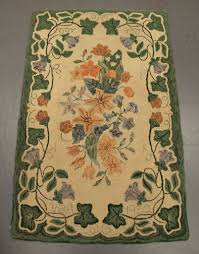 vintage hand hooked rug with a pretty fl fl pattern signed uda and dated 1952