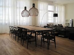 scandinavian style dining room with a live edge table design laux interiors berlin