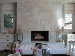 view in gallery glamorous living room with a marble fireplace