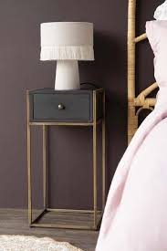 black wood and brass leg bedside table