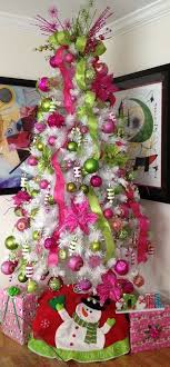 Source Source. A white Christmas tree, decorated ...