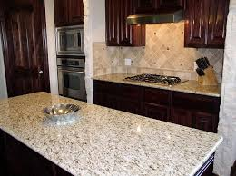 Tile Backsplashes With Granite Countertops Unique Tile Backsplash With Giallo Ornamental Granite Countertops DFW