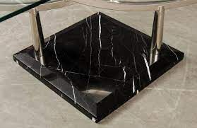 two tiered glass coffee table with a